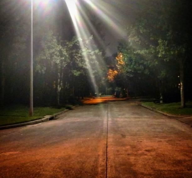 Night Street Lit by Streetlamp stock photo