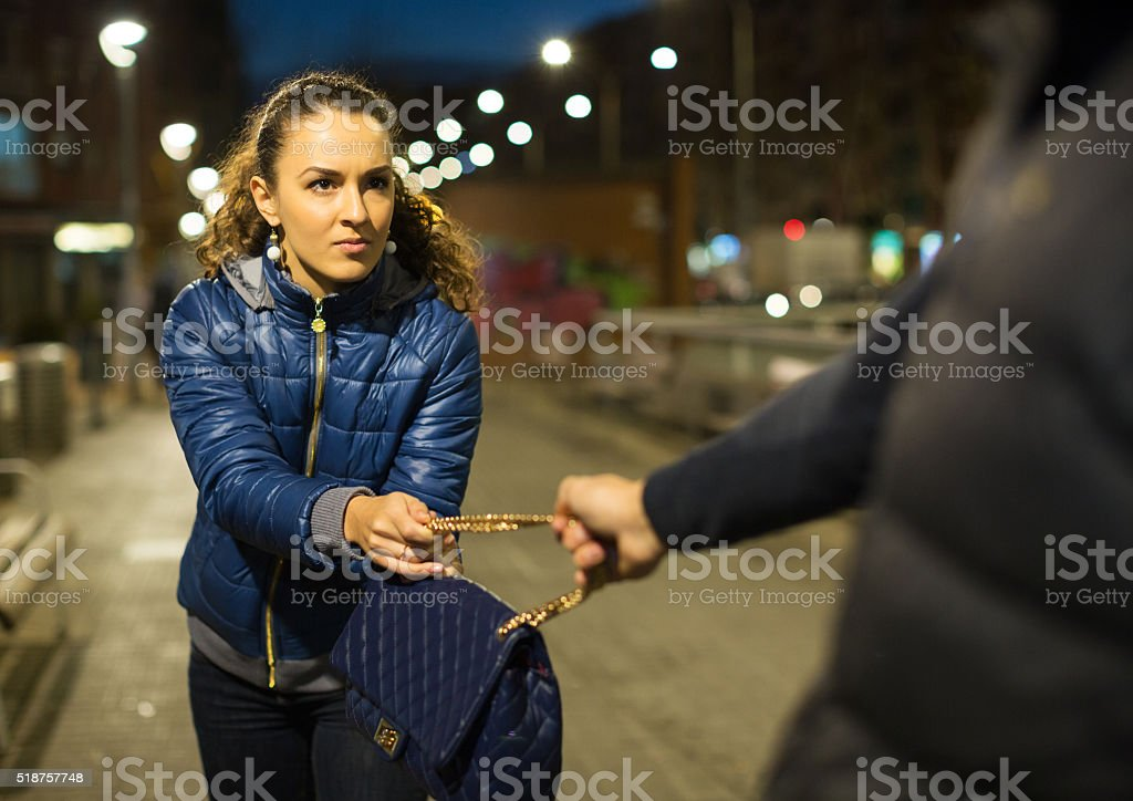 Night street robbery scene stock photo
