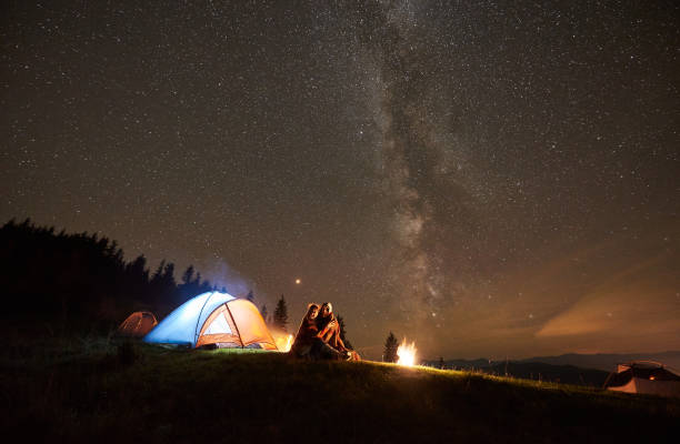 night summer camping in the mountains under night starry sky - camping imagens e fotografias de stock
