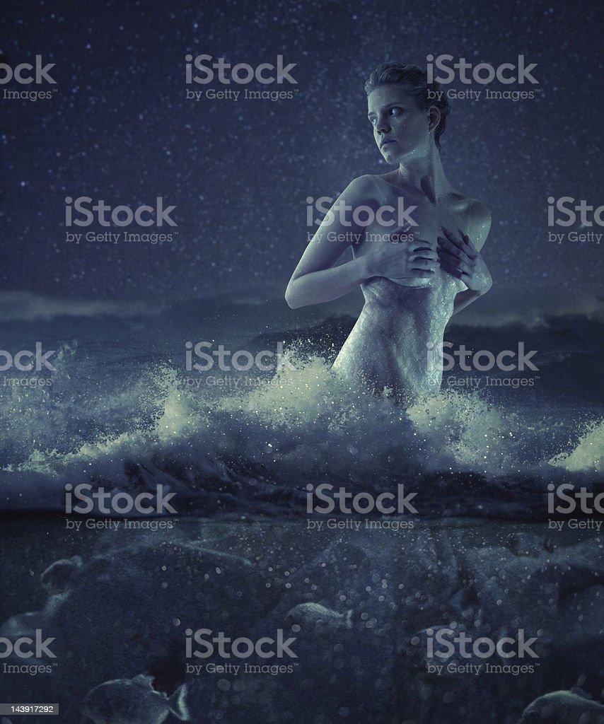 Night swiming in the sea stock photo