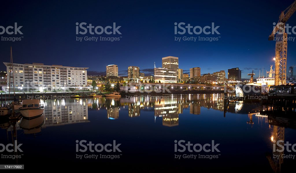 Night Thea Foss Waterway Downtown Tacoma Waterfront Skyline Working Harbor Night falls behind the Tacoma skyline and boats on Thea Foss Waterway Apartment Stock Photo