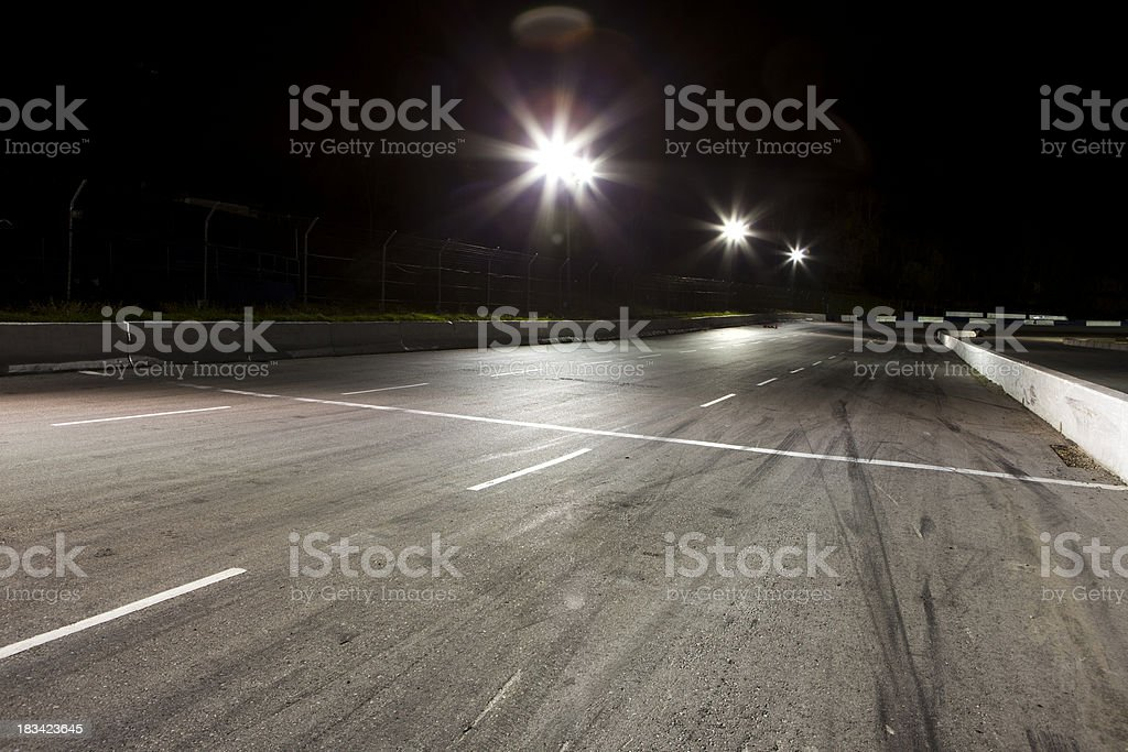 Night time at the race track stock photo