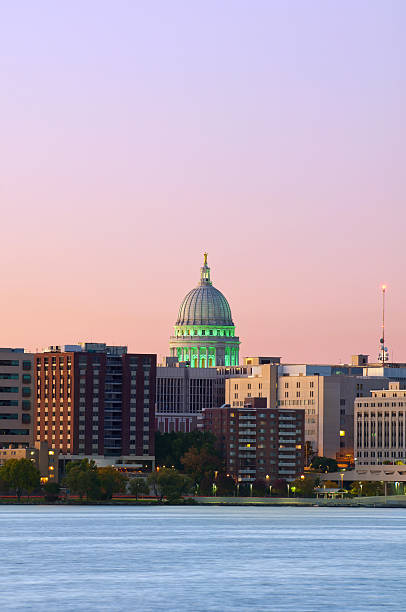 Night time cityscape of Madison Image of Madison downtown skyline at twilight with state capitol building. wisconsin state capitol stock pictures, royalty-free photos & images