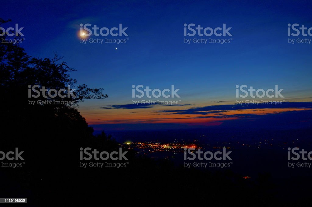 Night time in Shenandoah National Park, with moon, city lights, and...