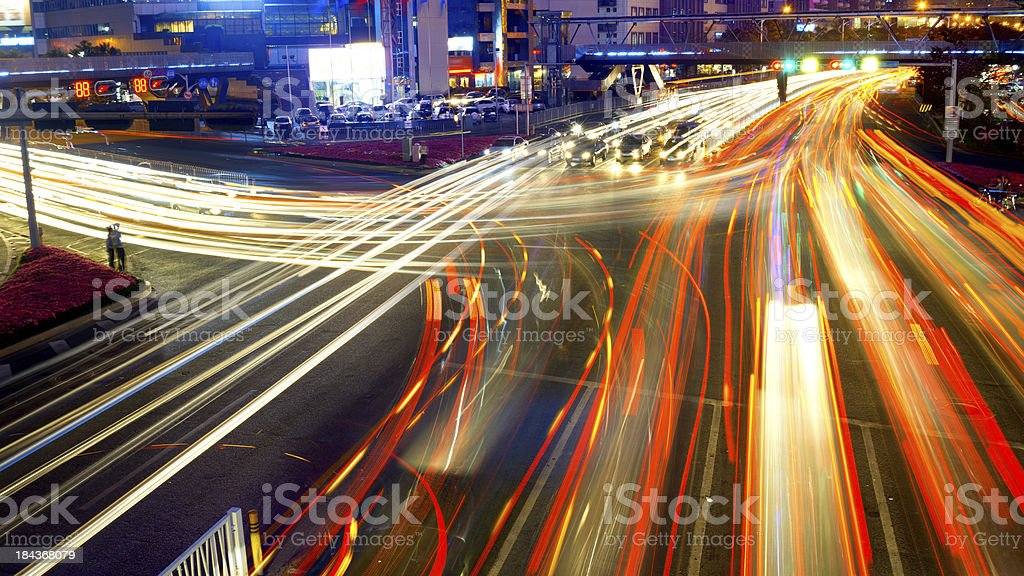 Night time  lapse photo of a city street full of cars stock photo