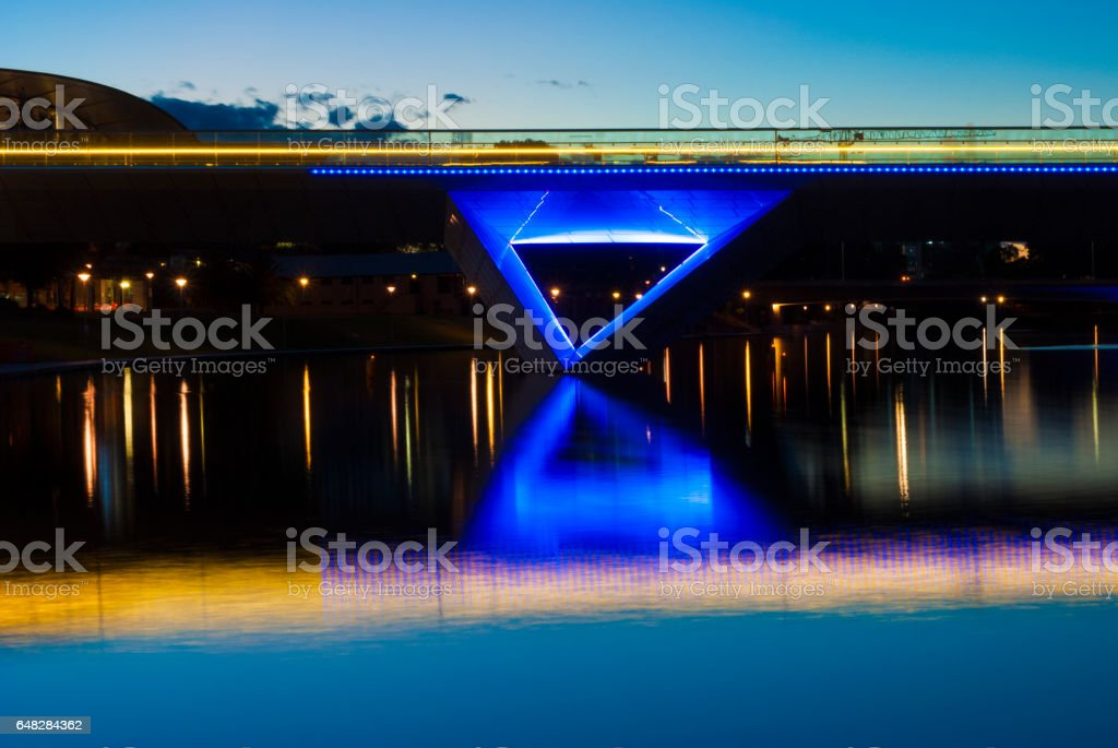 Night Time Lights on the Adelaide Oval Foot Bridge and Reflection stock photo