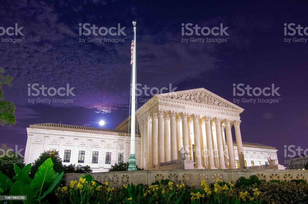 low angle view of the greek architectual styled columns of government...