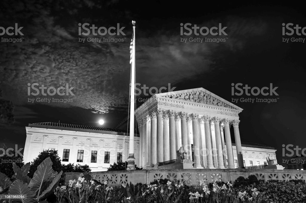 Black and white low angle view of the greek architectual styled...