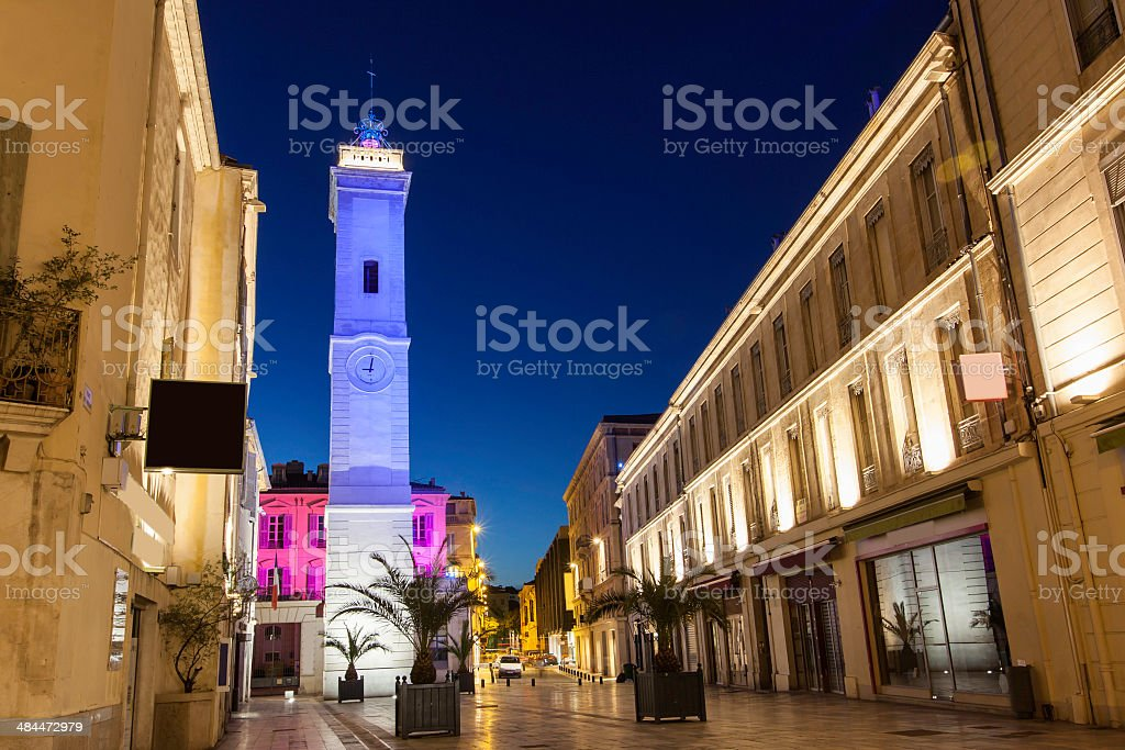 Night time view of clock tower, Nimes France stock photo