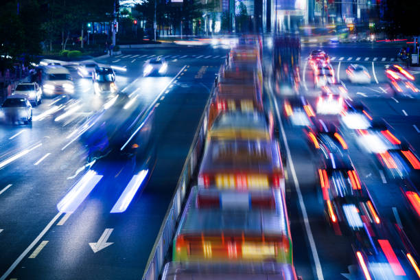 Night traffic in the city Night traffic in the city bus rapid transit stock pictures, royalty-free photos & images