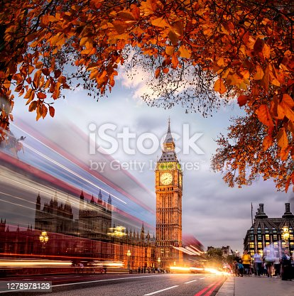 istock Night traffic jam with autumn leaves against Big Ben in London, England, UK 1278978123
