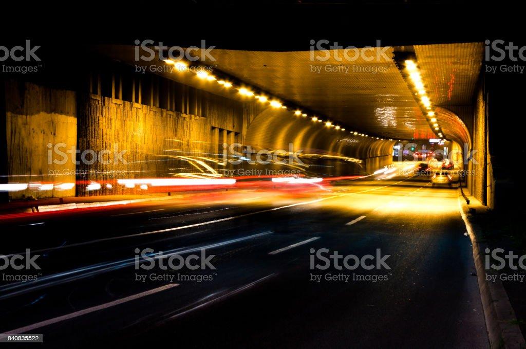 Night traffic on city street tunnel stock photo