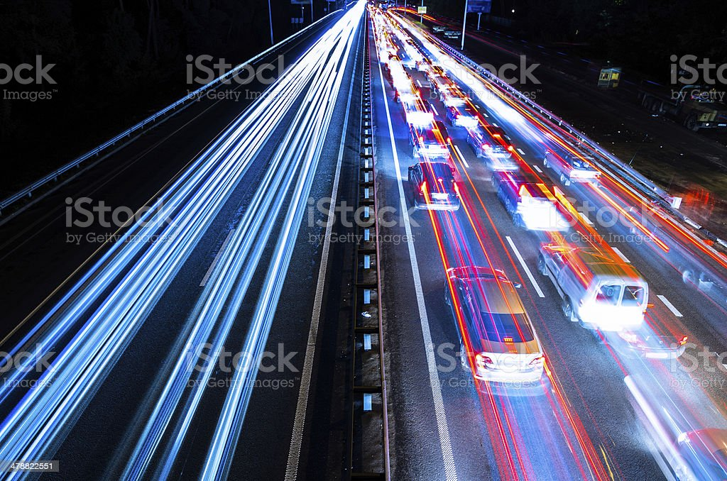 Night traffic with blurred traces from cars stock photo