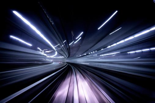 Night blur traveling through a tunnel. Tokyo, Japan