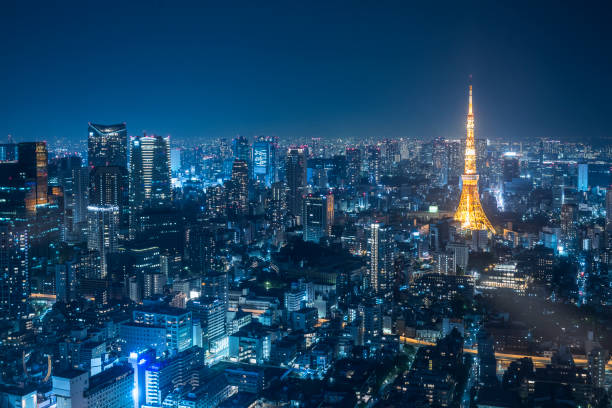 night urban skyline and tokyo tower - tokyo japan stock photos and pictures