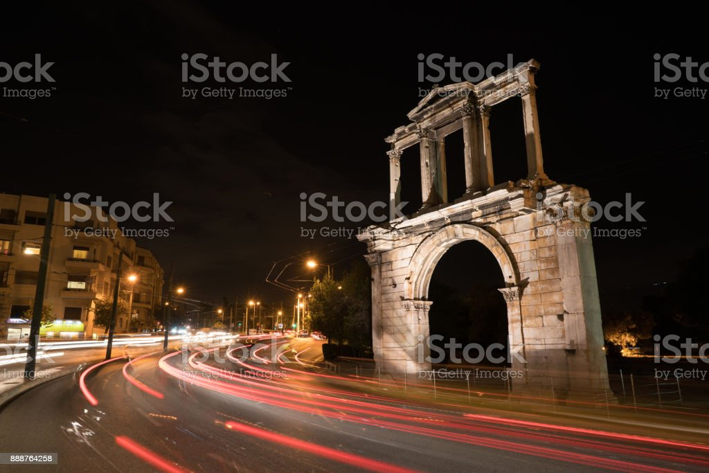 Night view Arch of Hadrian that leads to the pillars of Zeus's archaeological site stock photo