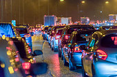 Night view busy UK Motorway traffic jam at night.