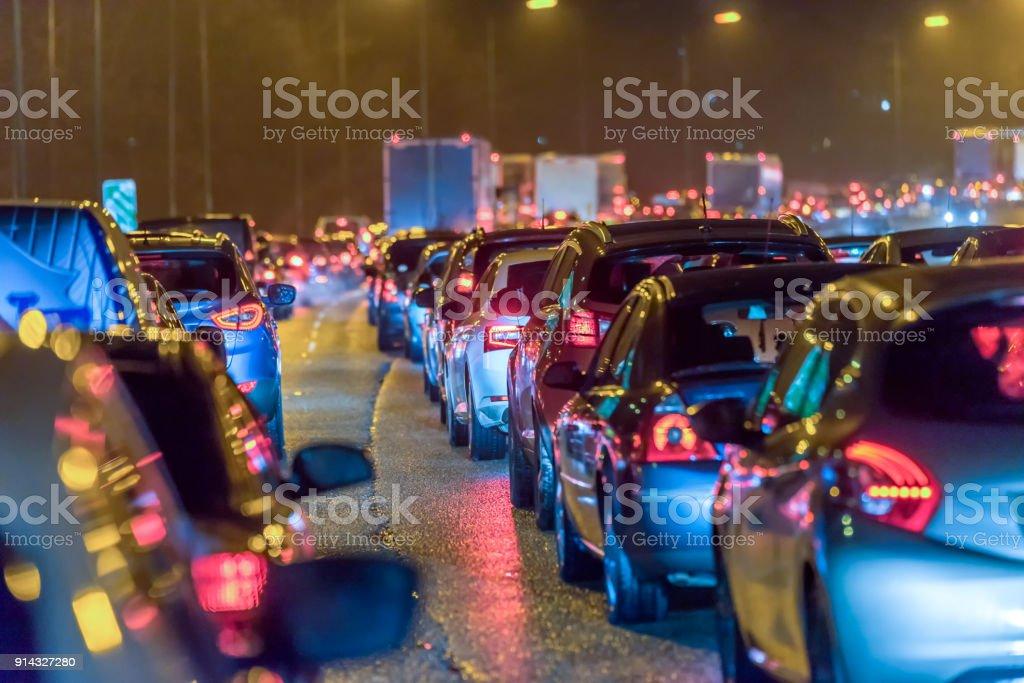 Night view busy UK Motorway traffic jam at night stock photo