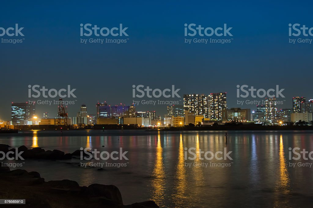 Night view city with mirror reflection in Tokyo Bay stock photo