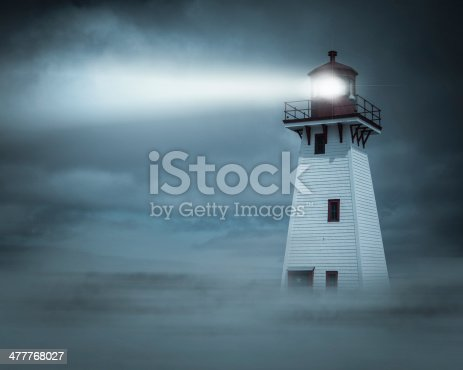 Lighthouse in New Brunswick, Canada,  in fog, mist and clouds at night.