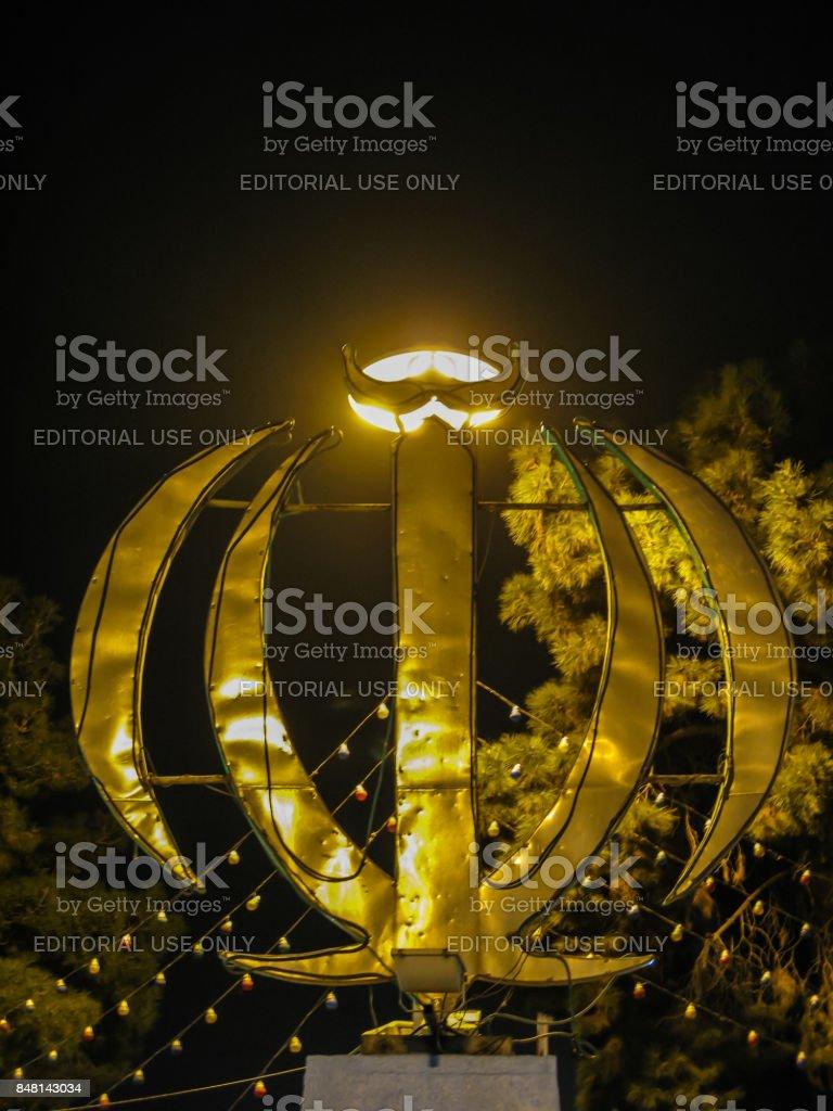 Night view Monument emblem of Iran, word Allah, Yazd, Iran stock photo