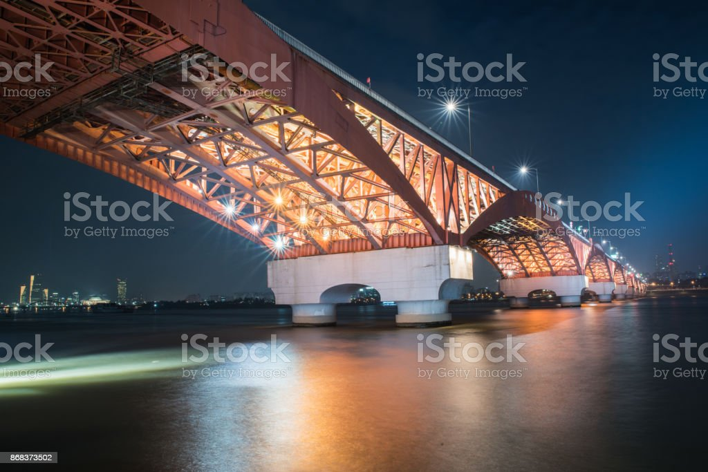 Night view of a bridge over a river in Seoul stock photo