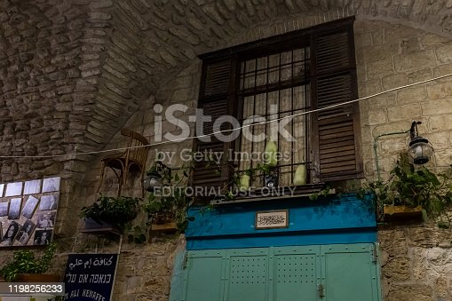 istock Night view of a decoratively decorated street in the old part of Nazareth in Israel 1198256233