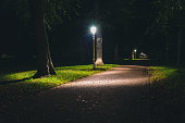 istock Night view of a dutch park and lightning lamp posts. 903701892