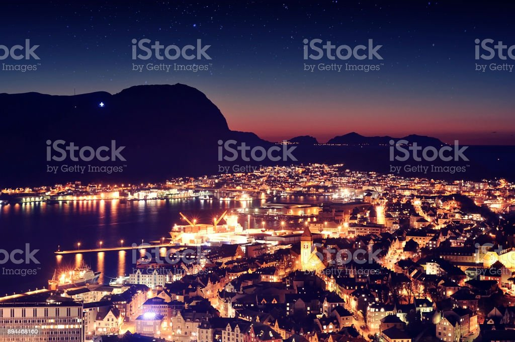 Night view of a small Norwegian town Alesund, winter time in Norway stock photo
