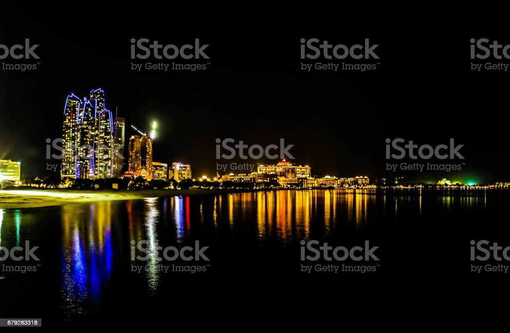 Night view of Abu Dhabi Skyscrapers and Skyline at Corniche, United Arab Emirates stock photo