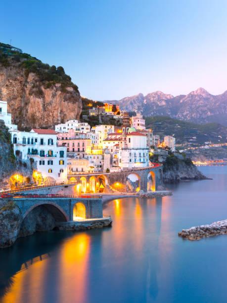 night view of amalfi on coast line of mediterranean sea, italy - milan fiorentina foto e immagini stock