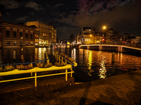 Amsterdam, The Netherlands.  June, 2014.  Night view of one of the canals of the Dutch city of Amsterdam