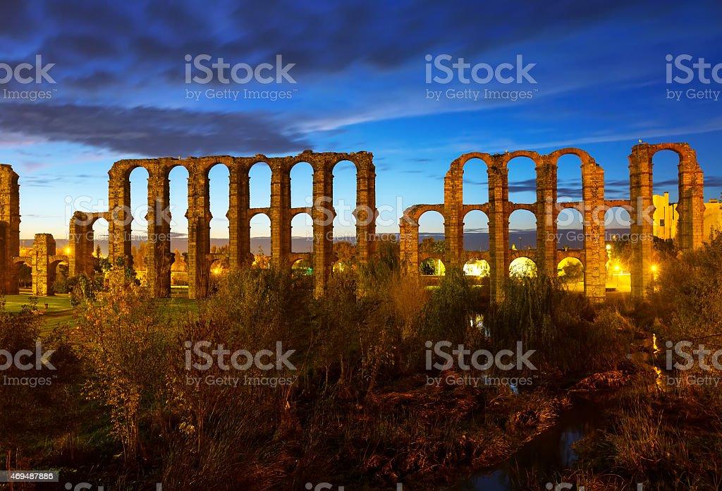 night view of ancient roman aqueduct stock photo
