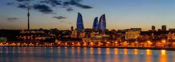 Night view of Baku with the Flame Towers skyscrapers stock photo