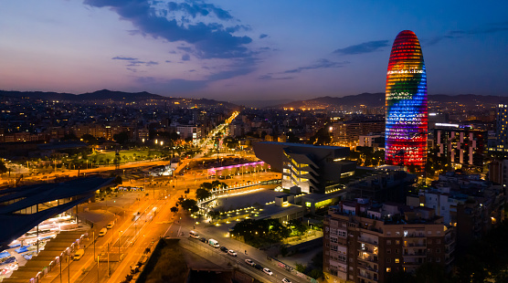 Night view of Barcelona cityscape with Torre Glories