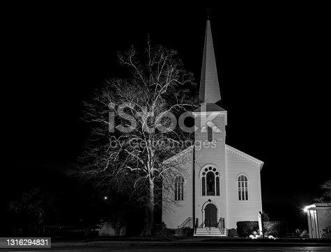 istock Night view of Barrington Congregational church in Barrington 1316294831