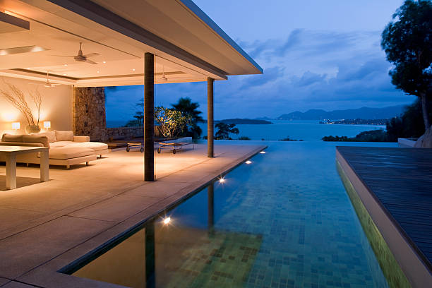 night view of beautiful villa on island - hawaii home stock photos and pictures