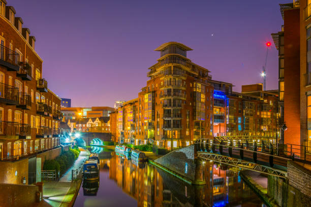 Night view of brick buildings alongside a water channel in the central Birmingham, England stock photo