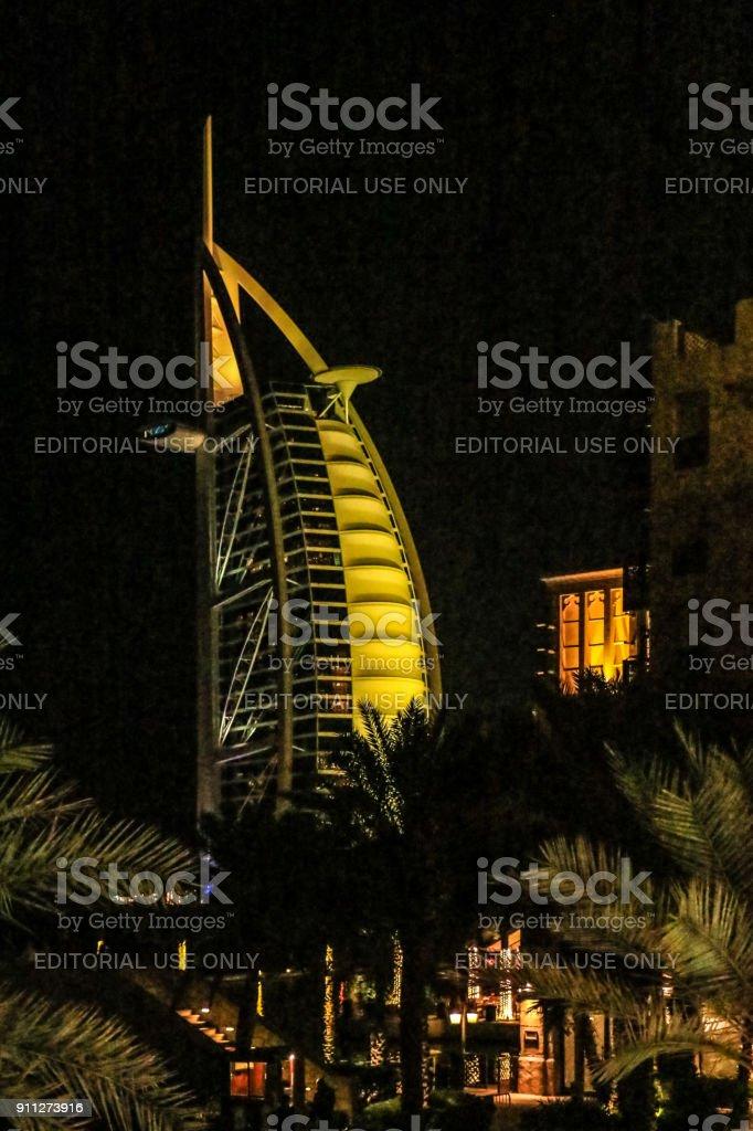 Night view of Burj Al Arab, Seven Star Hotel, A view from Jumeirah Beach, Arabian Sea, Residential and Business Skyscrapers, Dubai, United Arab Emirates stock photo