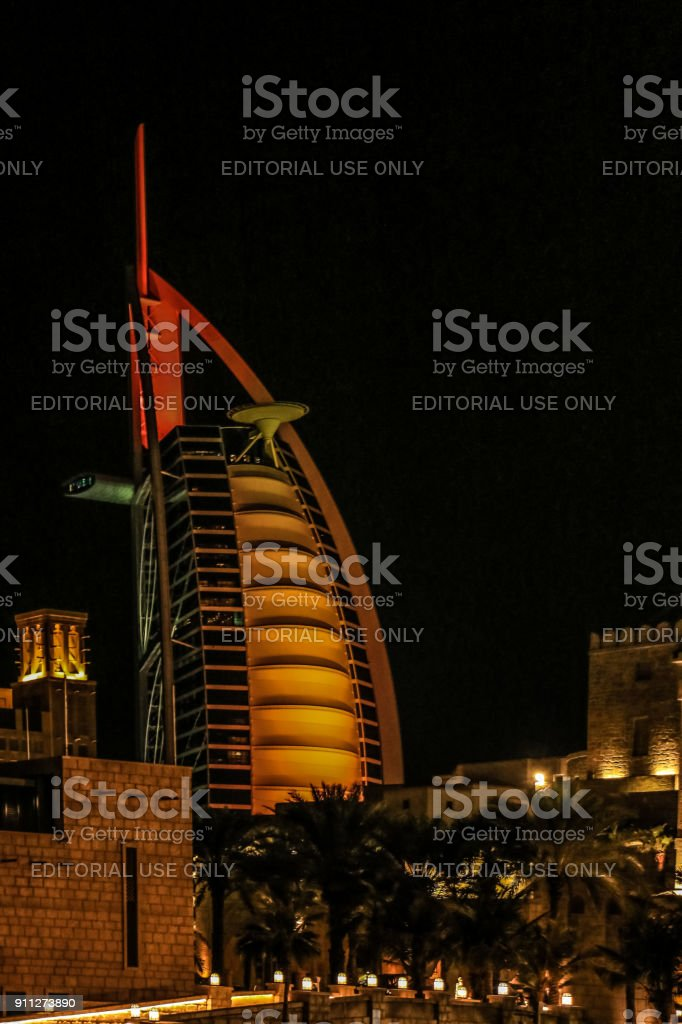 Night view of Burj Al Arab, Seven Star Hotel, A view from Souk Madinat Jumeirah, Residential and Business Skyscrapers, Dubai, UAE stock photo