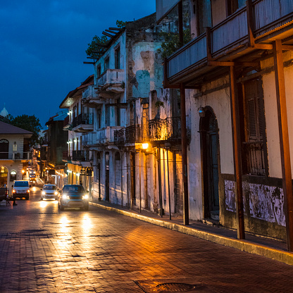 A night view of Casco Viejo also called Casco Antiguo, Panama City's Old Quarter established in 1673, with its old buildings, cars and paved street.