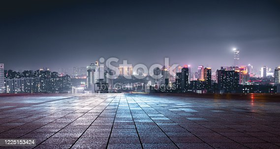 Night view of city lights in front of marble square, Xuzhou, China