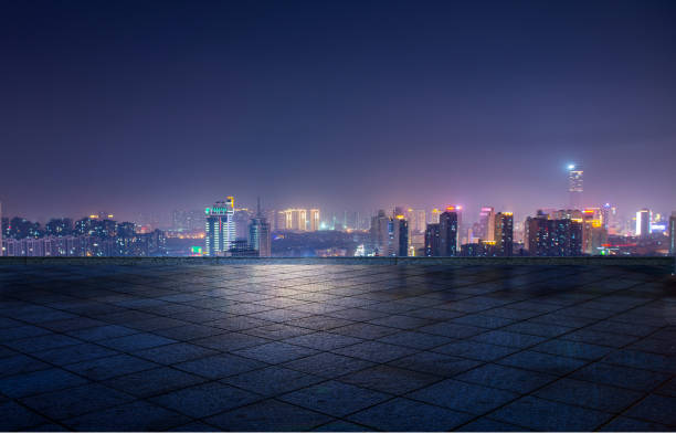 Night view of city lights in front of marble square, Xuzhou, China Night view of city lights in front of marble square, Xuzhou, China huangpu river stock pictures, royalty-free photos & images