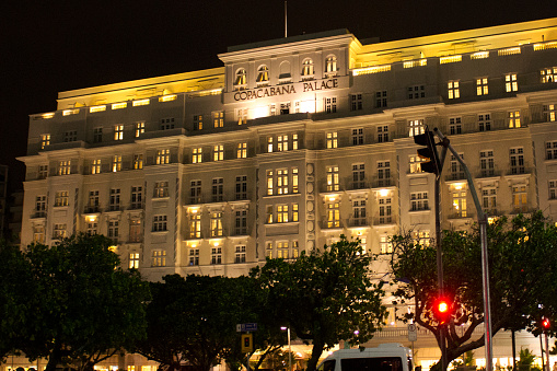 Night view of Copacabana Palace Hotel in Rio de Janeiro. Illuminated front of the traditional Copacabana Palace hotel during the carioca night.