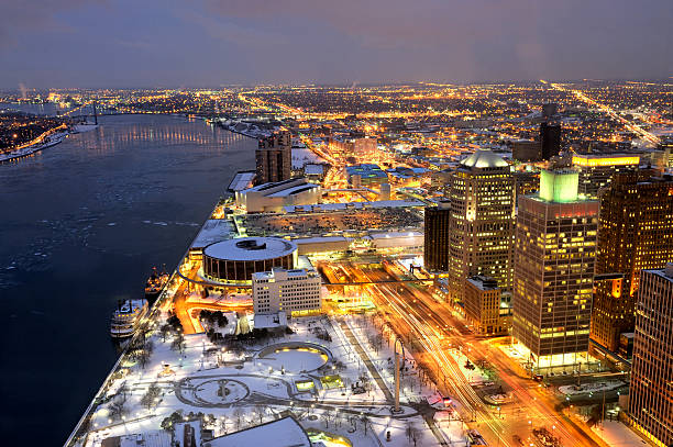 Night View of Detroit, Michigan USA A helicopter point of view of Detroit at night, looking south. The Ambassador Bridge to Canada is seen in the top left of the image. detroit michigan stock pictures, royalty-free photos & images