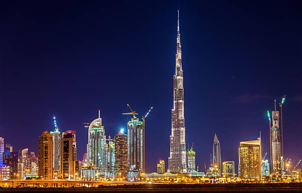 Night view of Dubai Downtown with Burj Khalifa Night view of Dubai Downtown with Burj Khalifa burj khalifa stock pictures, royalty-free photos & images
