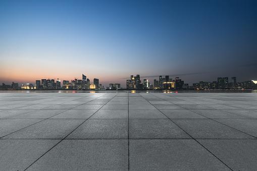 istock night view of empty brick floor front of modern building 1140684108