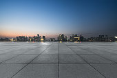 istock night view of empty brick floor front of modern building 1140684108