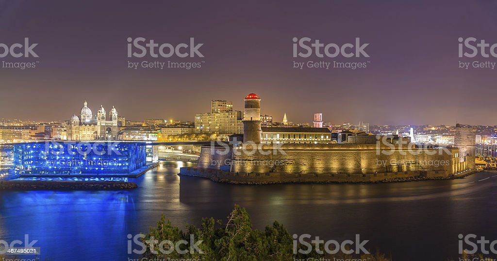 Night view of Fort Saint-Jean and Cathedral in Marseille, France stock photo