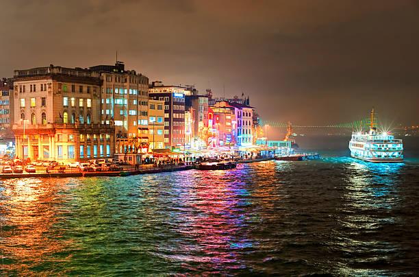 night view of galata quarter on bosporus in istanbul, turkey - каракёй стамбул стоковые фото и изображения